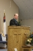 Brother Cox preparing to preach